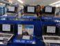 Seorang pramuniaga menyusun produk elektronik pada pameran elektronik di mal Tangerang City, Tangerang, Banten, Kamis (28/8). Berdasarkan data Kemendag total nilai pasar e-commerce (perdagangan elektronik) Indonesia pada pertengahan 2013 hingga Januari 2014 diprediksi mencapai 8 miliar dollar AS, dan diperkirakan hingga mencapai 24 milliar dollar AS.ANTARA FOTO/Lucky R./ed/pd/14